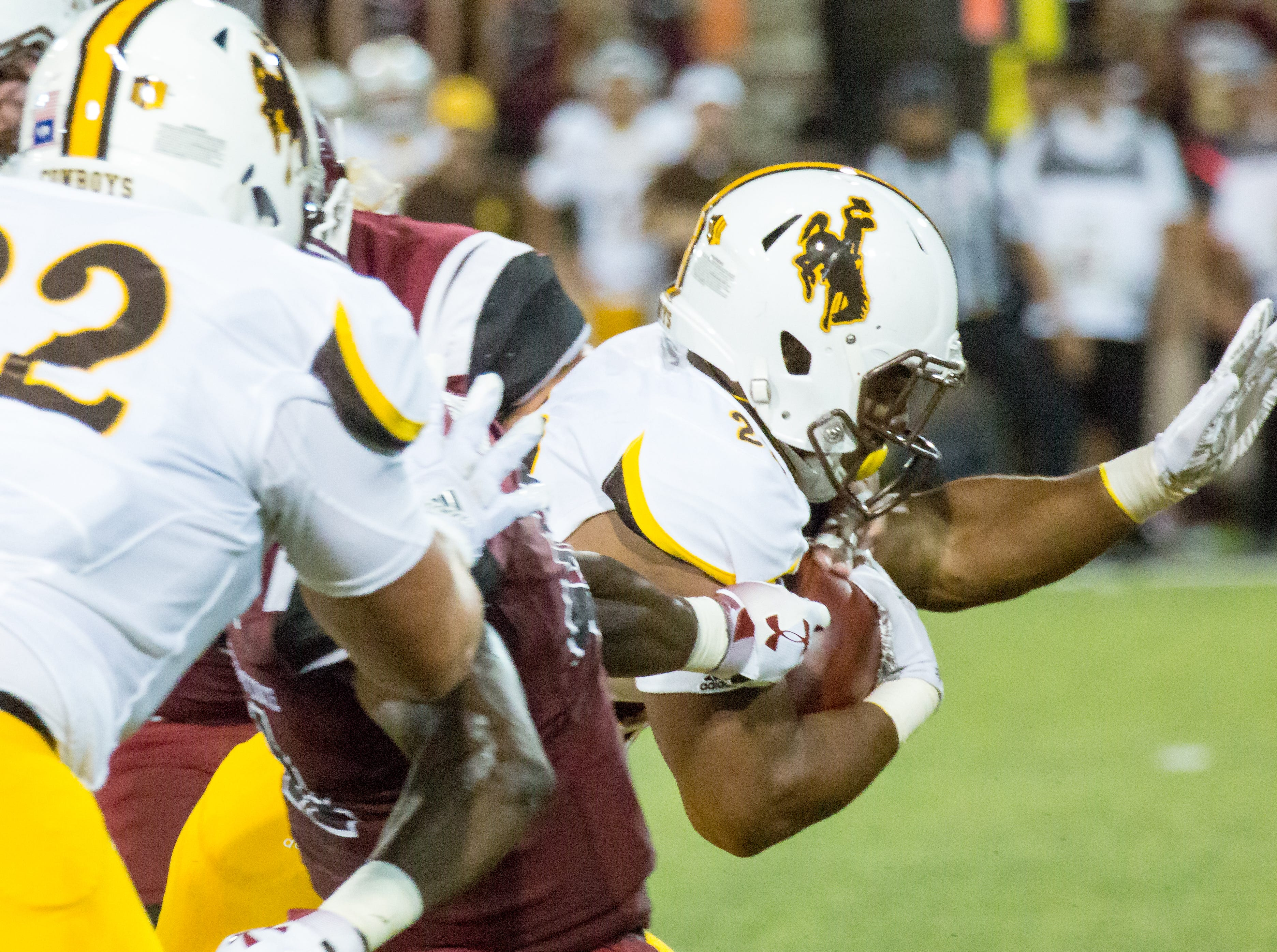 Wyoming running back Nico Evans reaches foward as he looks for more yards on Saturday, August 25, 2018, during the NMSU/Wyoming game at the Aggie Memorial Stadium.