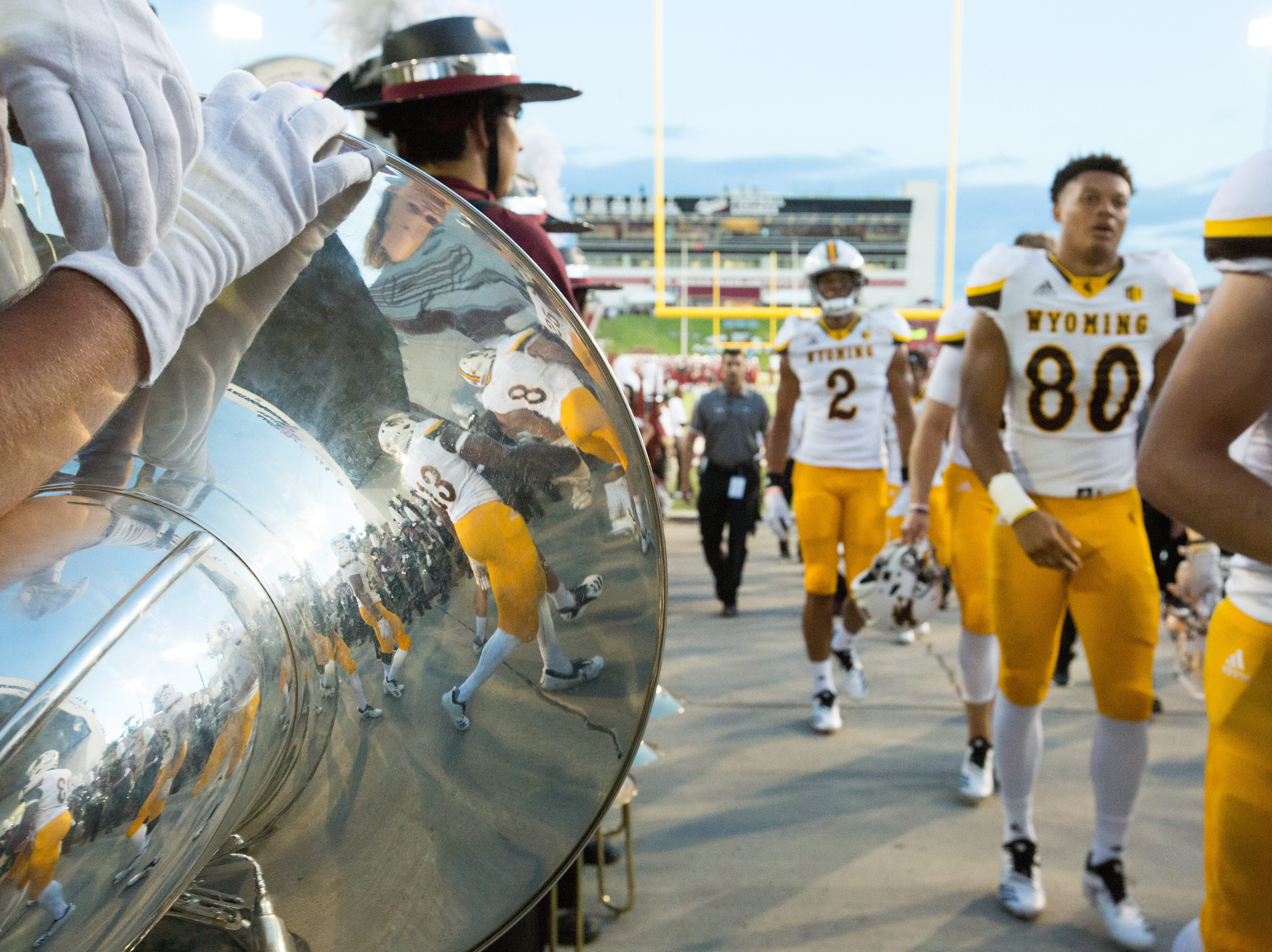 The  Wyoming football team walks up the ramp before the game on Saturday, August 25, 2018, during the NMSU/Wyoming game at the Aggie Memorial Stadium.