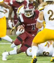 NMSU running back Jason Huntley looks for yards on Saturday, August 25, 2018 as the Aggies take on Wyoming at Aggie Memorial Stadium.