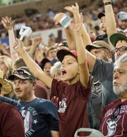 Fans cheer on Saturday, August 25, 2018, during the NMSU/Wyoming game at the Aggie Memorial Stadium.