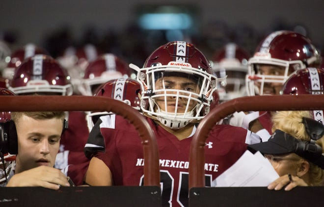 New Mexico State plays at Utah State in a rematch of last year's Arizona Bowl.