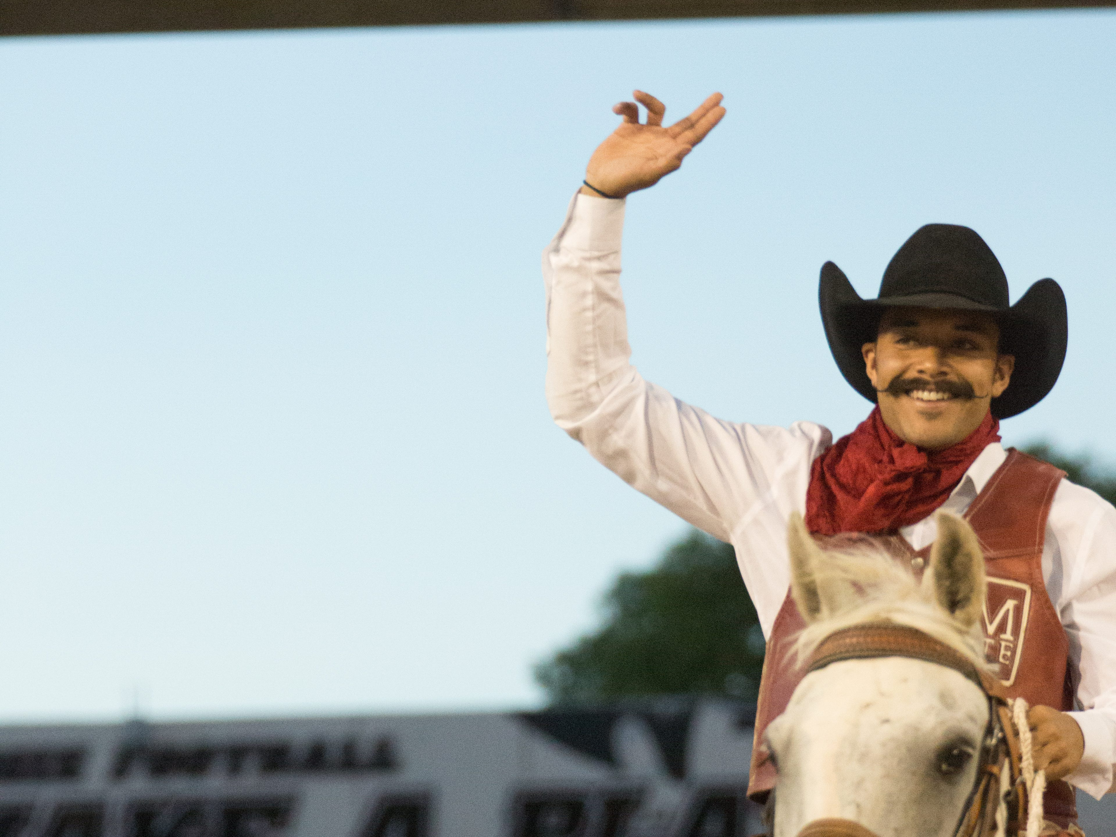 Pistol pete throws his guns up on Saturday, August 25, 2018, during the NMSU/Wyoming game at the Aggie Memorial Stadium.