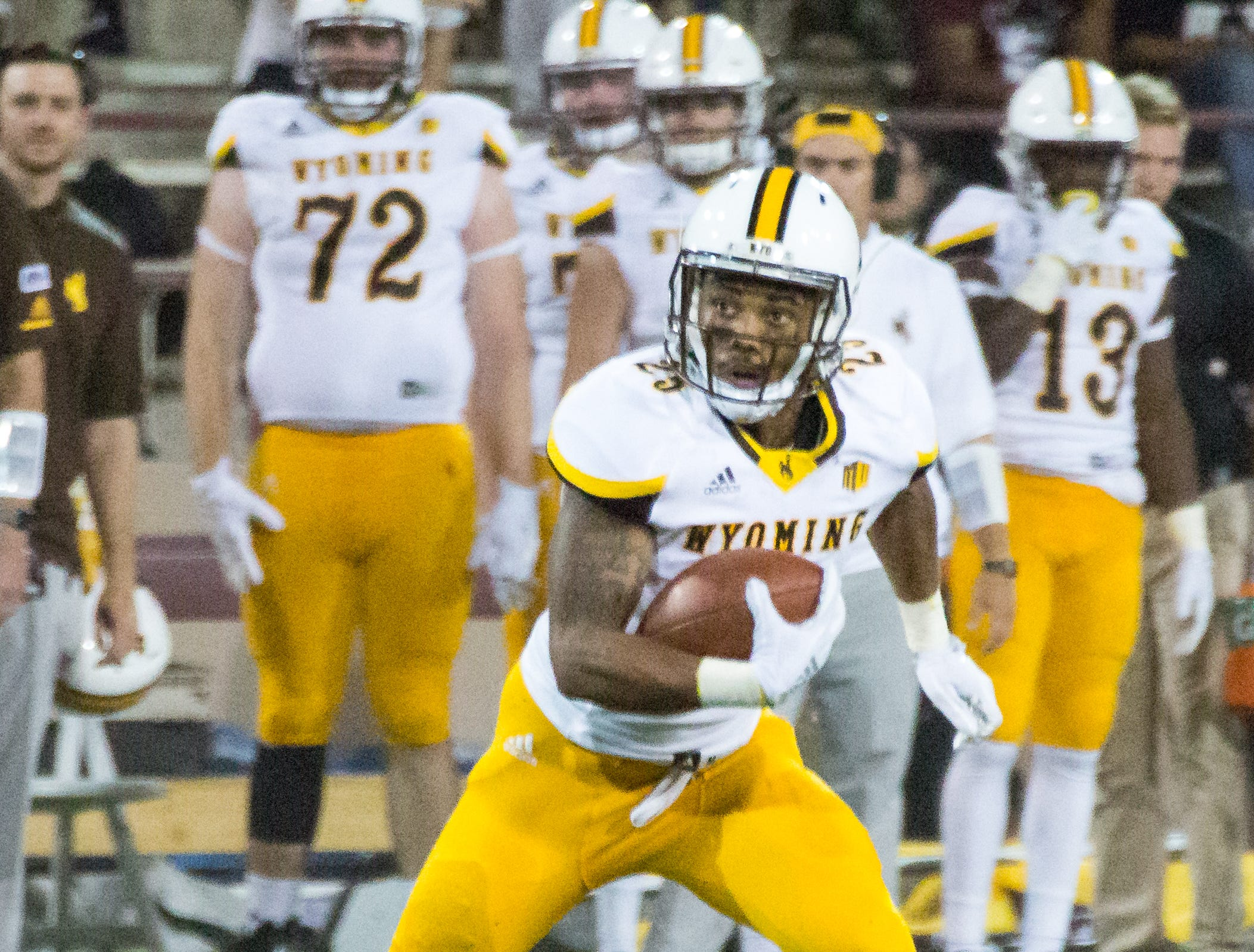 Wyoming's Austin Conway runs with the ball on Saturday, August 25, 2018, during the NMSU/Wyoming game at the Aggie Memorial Stadium.