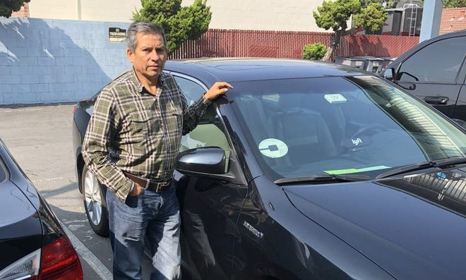 Edhuar Arellano has been driving for Uber and Lyft for four years. He says the companies should make drivers employees.