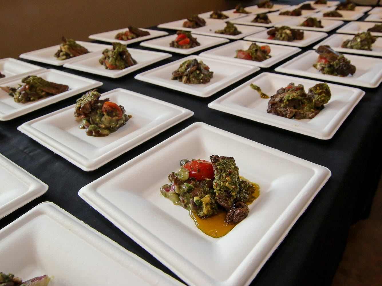 Ever'man Grocery and Cafe offered an Argentinian skirt steak and black bean chimichurri salad and a choice of four wines during the Pensacola News Journal's 5th annual Tastemakers restaurant crawl on Saturday, August 25, 2018. The two-night event included about a dozen restaurants that each featured a food and drink item reoresenting a specific country, such as the United States, Mexico, Argentina and more.