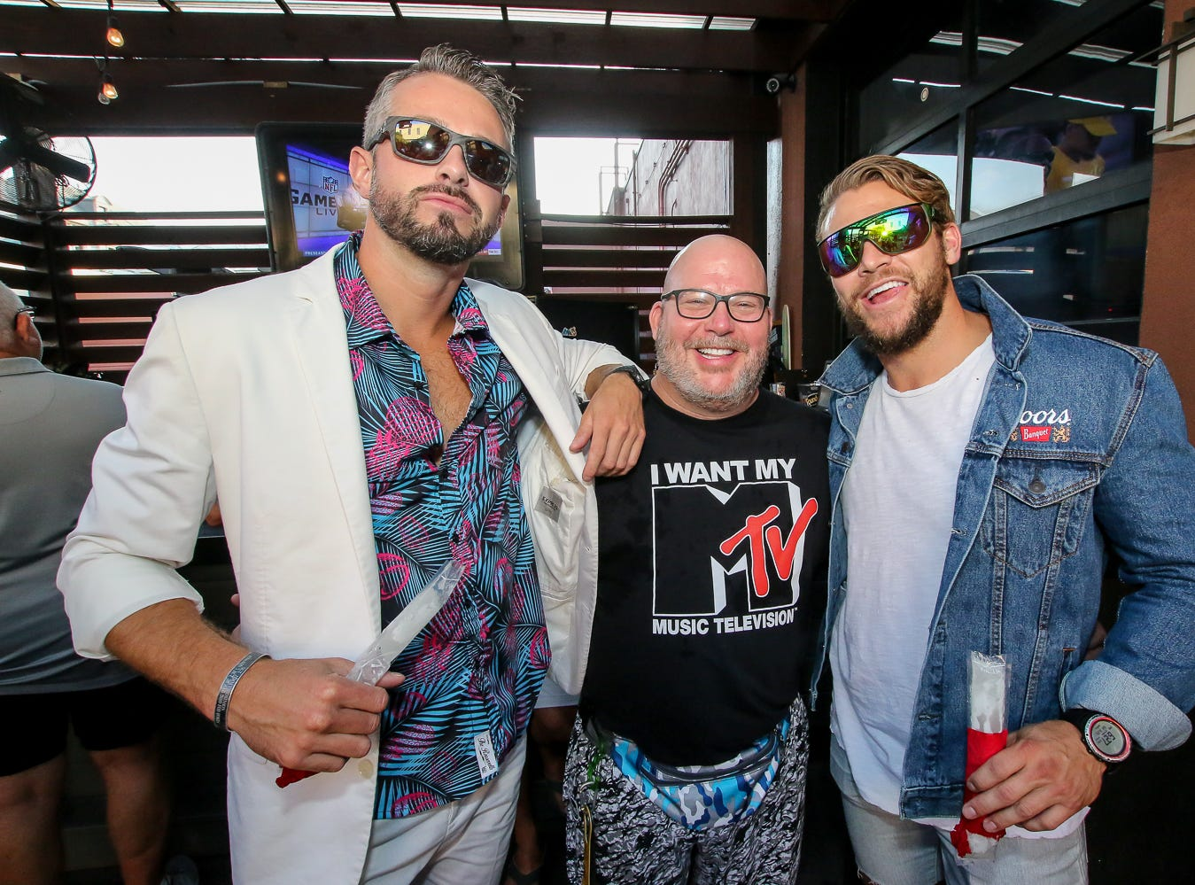 People enjoy the 1980's-themed bar crawl at Blend Lounge, Taco Agave, and World of Beer on Saturday, August 25, 2018.