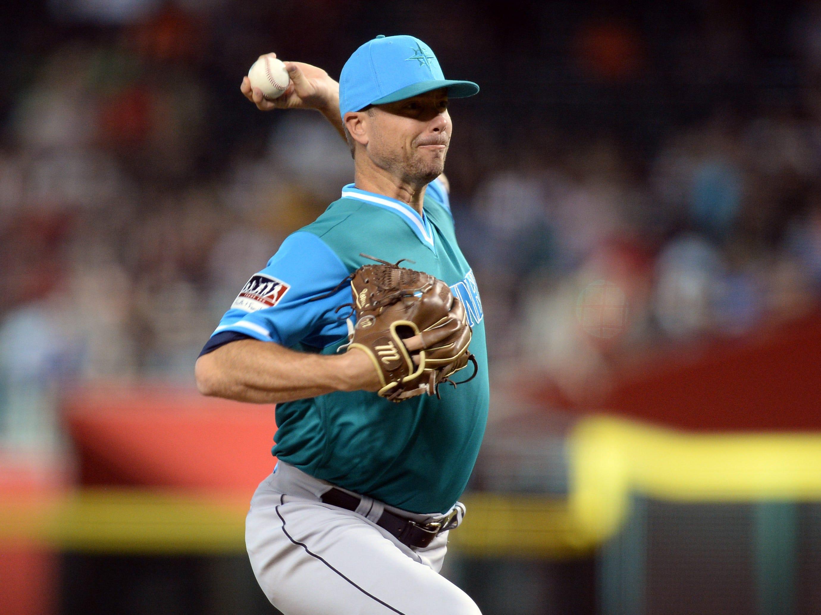 Aug 25, 2018; Phoenix, AZ, USA; Seattle Mariners starting pitcher Wade LeBlanc (49) pitches against the Arizona Diamondbacks during the first inning at Chase Field. Mandatory Credit: Joe Camporeale-USA TODAY Sports