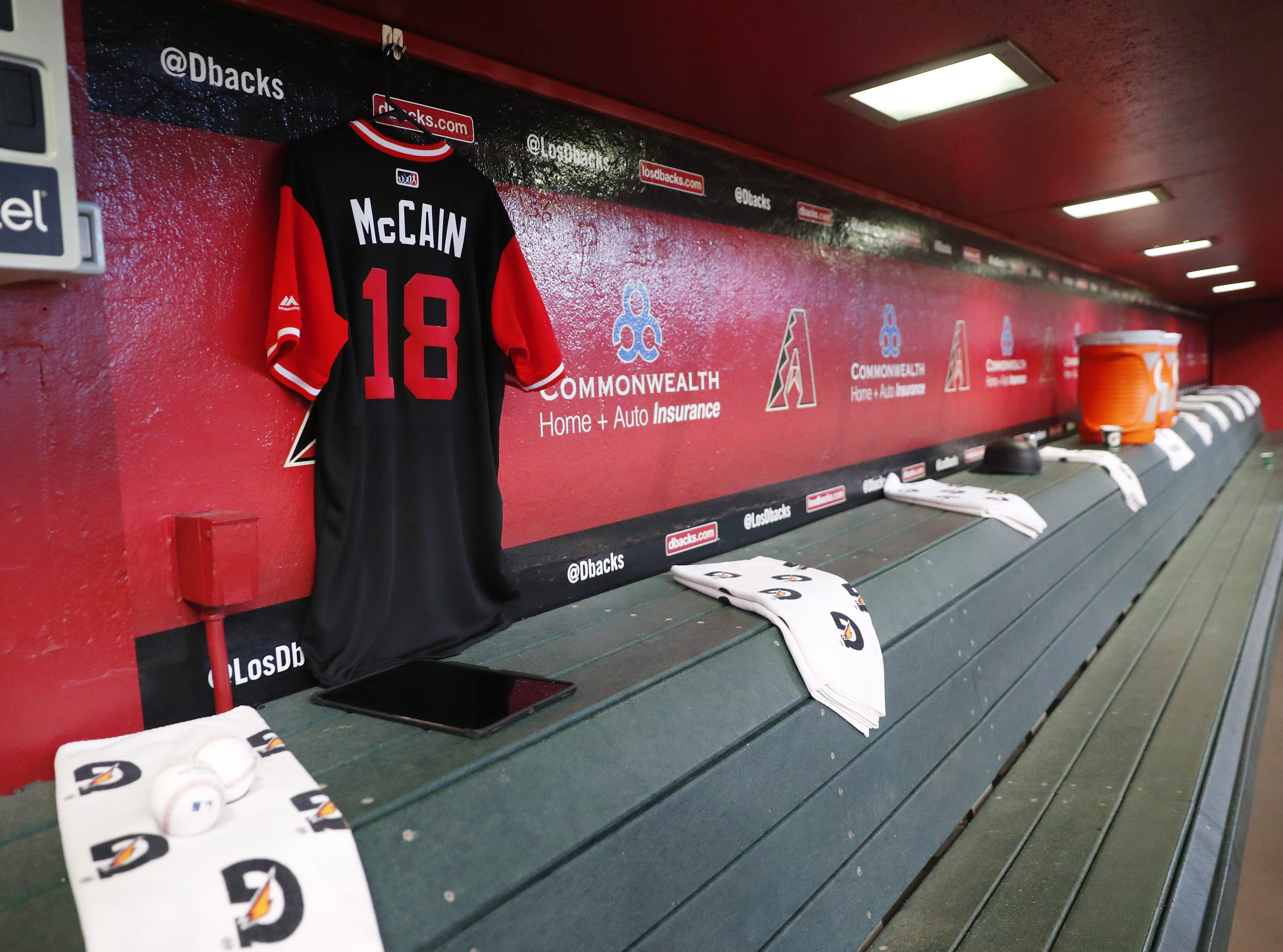 A jersey for Sen. John McCain, R-Ariz., hangs in the Arizona Diamondbacks' dugout Aug. 26. 2018, before the team's game against the Seattle Mariners. The six-term Arizona senator died Saturday at age 81.