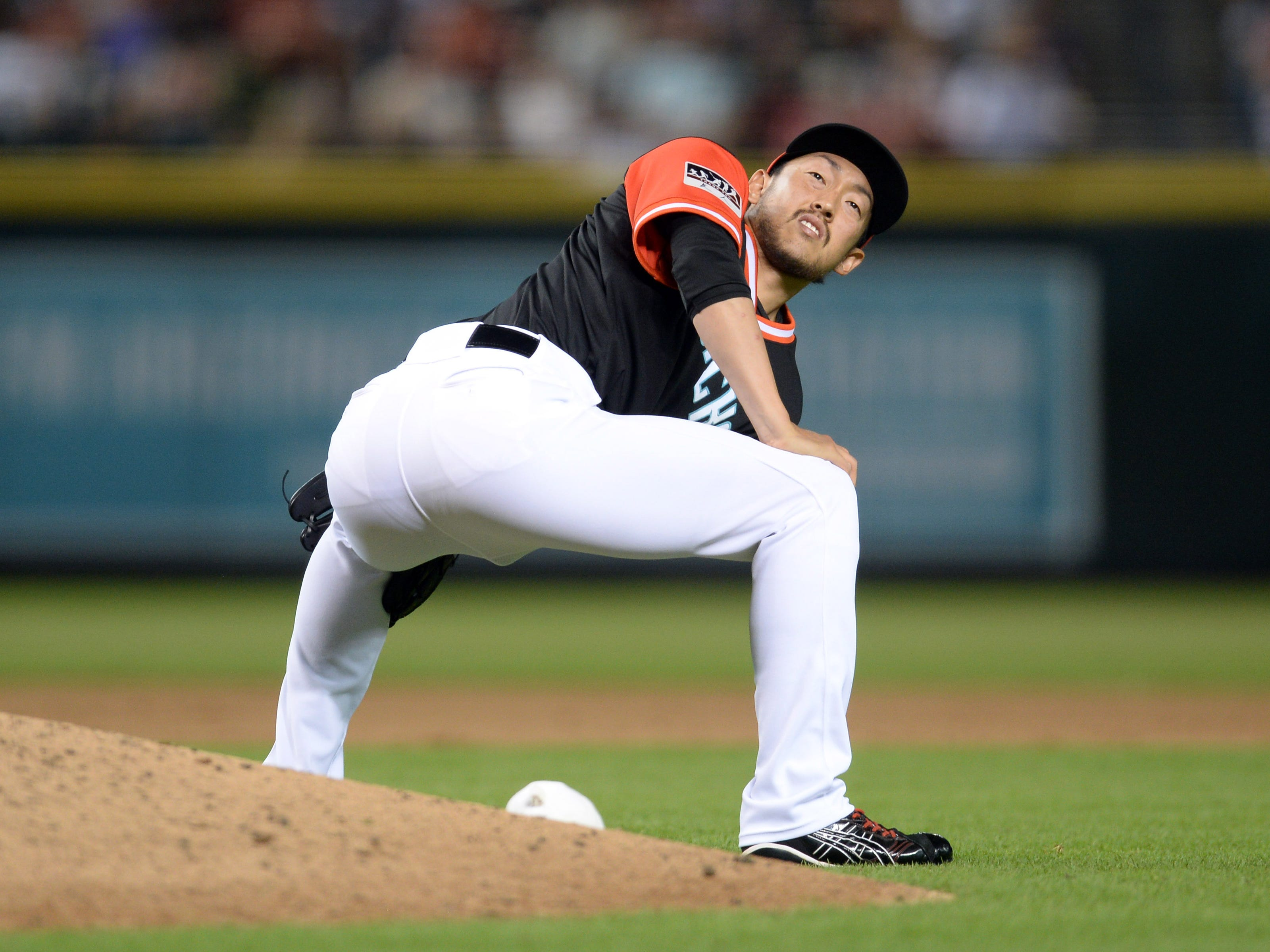 Aug 25, 2018; Phoenix, AZ, USA; Arizona Diamondbacks relief pitcher Yoshihisa Hirano (66) stretches against the Seattle Mariners during the eighth inning at Chase Field. Mandatory Credit: Joe Camporeale-USA TODAY Sports
