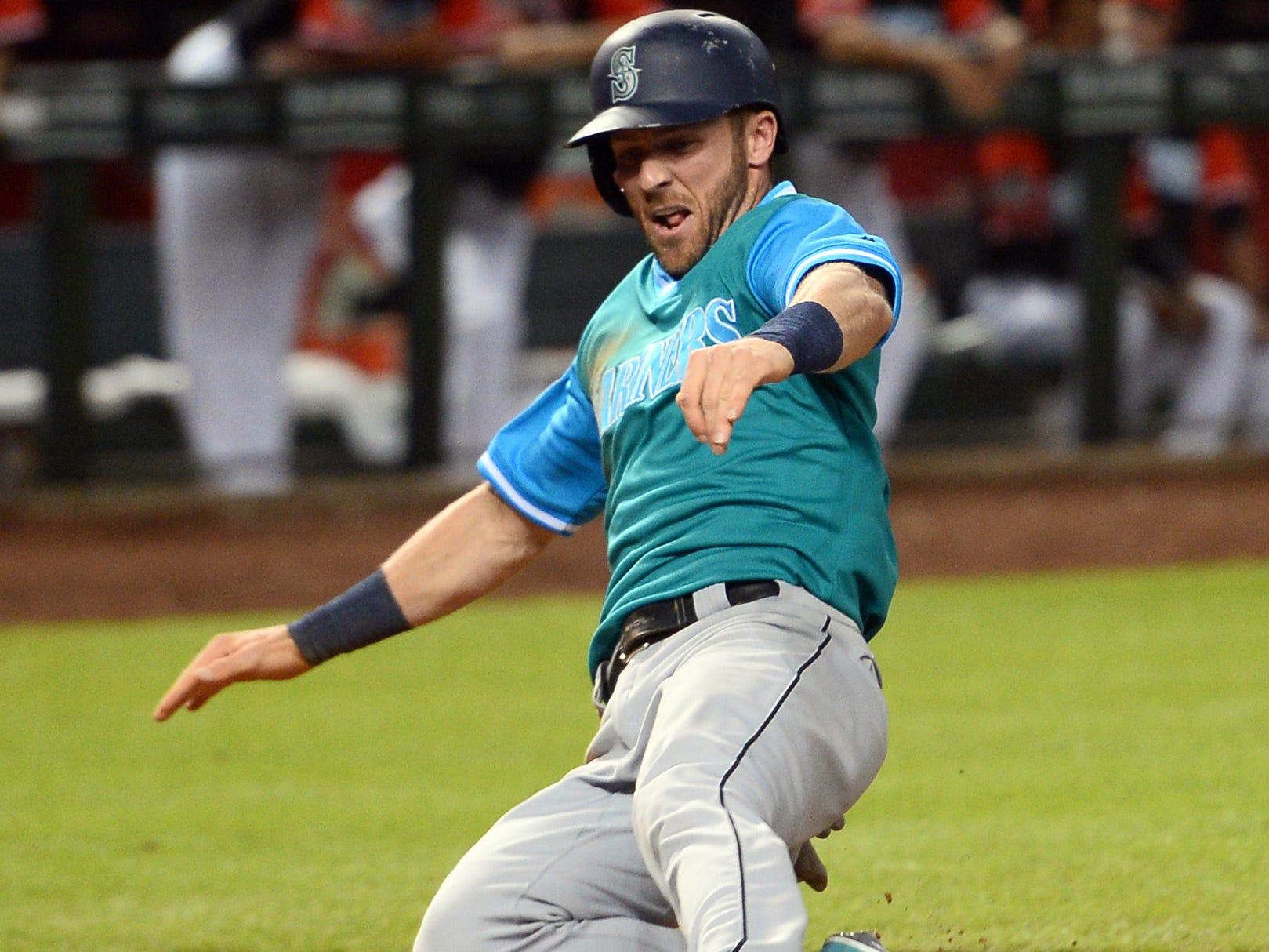 Aug 25, 2018; Phoenix, AZ, USA; Seattle Mariners shortstop Andrew Romine (7) scores a run against the Arizona Diamondbacks during the ninth inning at Chase Field. Mandatory Credit: Joe Camporeale-USA TODAY Sports