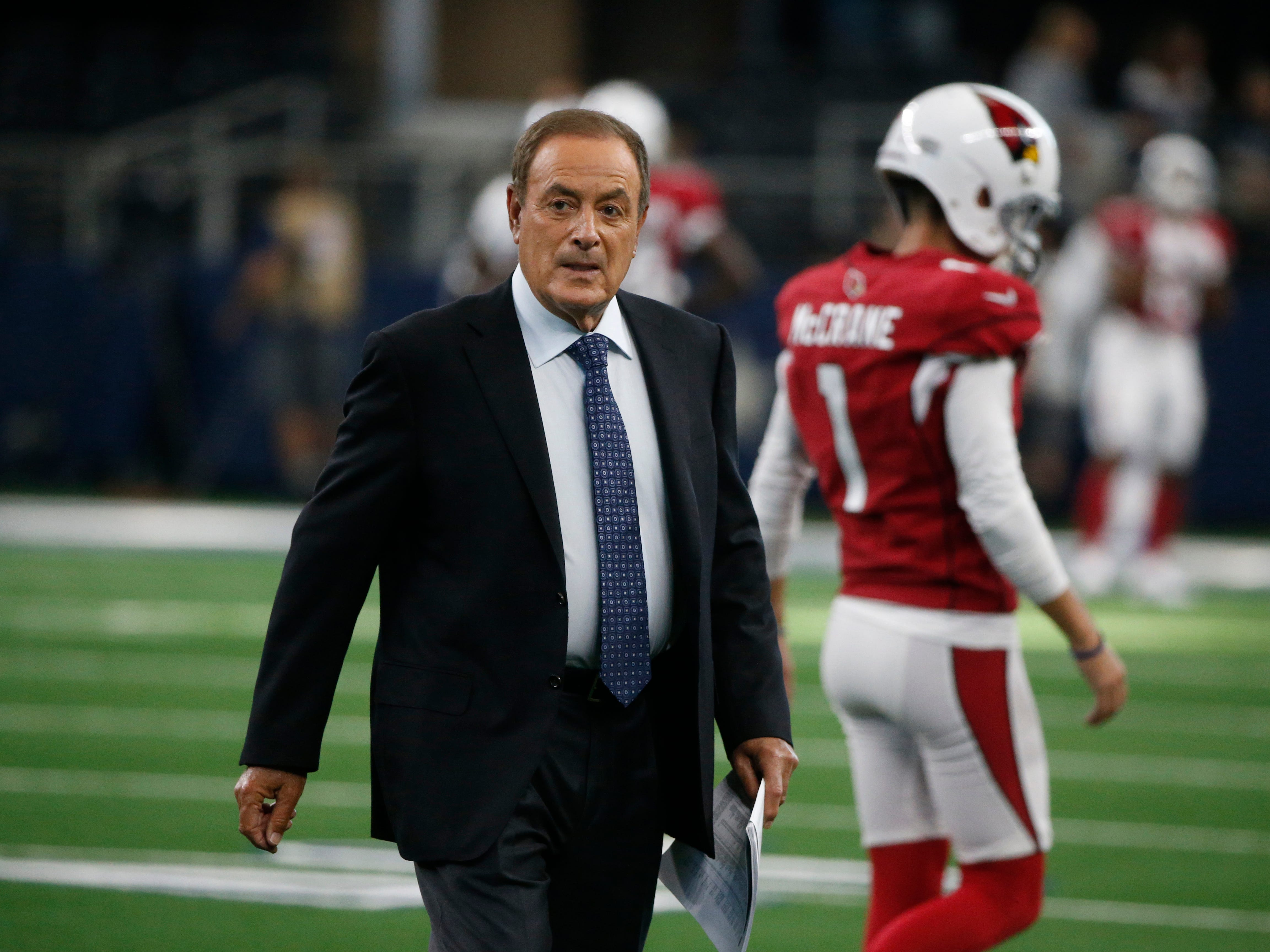 Al Michaels walks on the field before an preseason NFL football game between the Dallas Cowboys and the Arizona Cardinals in Arlington, Texas, Sunday, Aug. 26, 2018. (AP Photo/Michael Ainsworth)