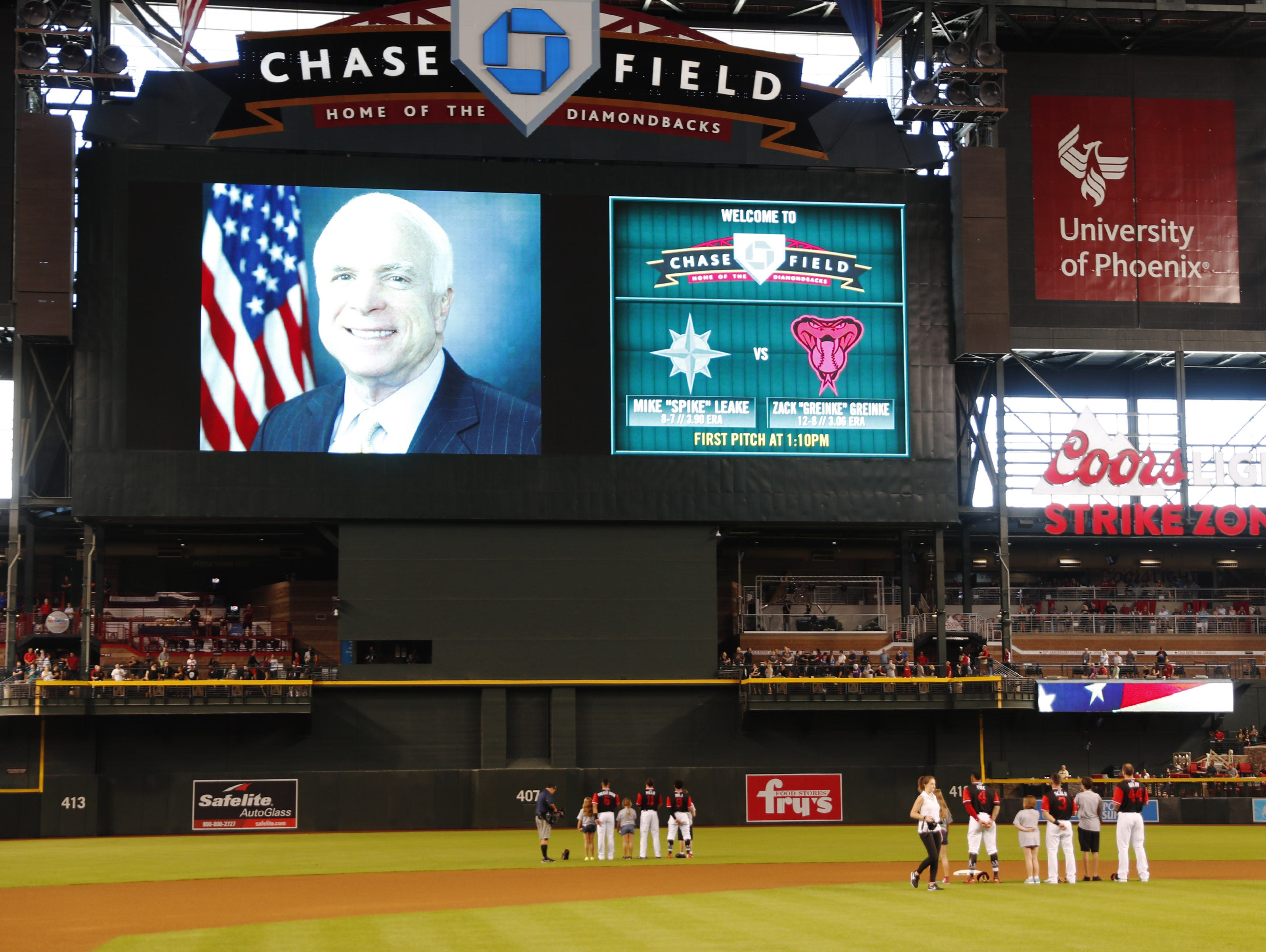 Arizona Diamondbacks players watch a video tribute to Sen. John McCain on Aug. 26. 2018, before playing against the Seattle Mariners at Chase Field in Phoenix. The six-term Arizona senator died Saturday at age 81.