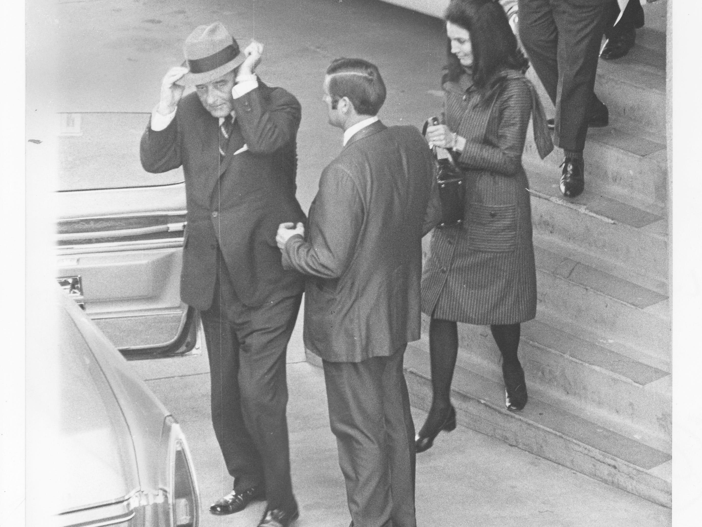 Former President Lyndon Johnson (left) attends the funeral of former U.S. Sen. Carl Hayden in Phoenix in 1972.