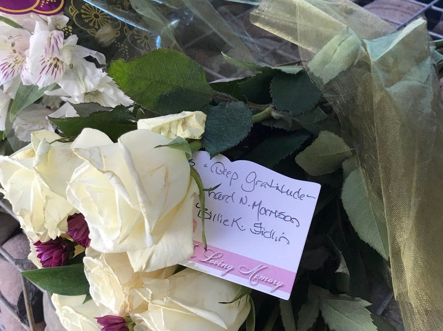 People left flowers, notes and candles outside Sen. John McCain's office on Aug. 26, 2018, as part of a growing memorial for the senator.