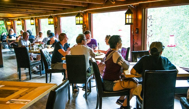 Customers enjoy the view from the Up the Creek Bistro Wine Bar in Cornville, Arizona, on Aug. 25, 2018. Sen. John McCain lived in Cornville and frequented the restaurant while in town.