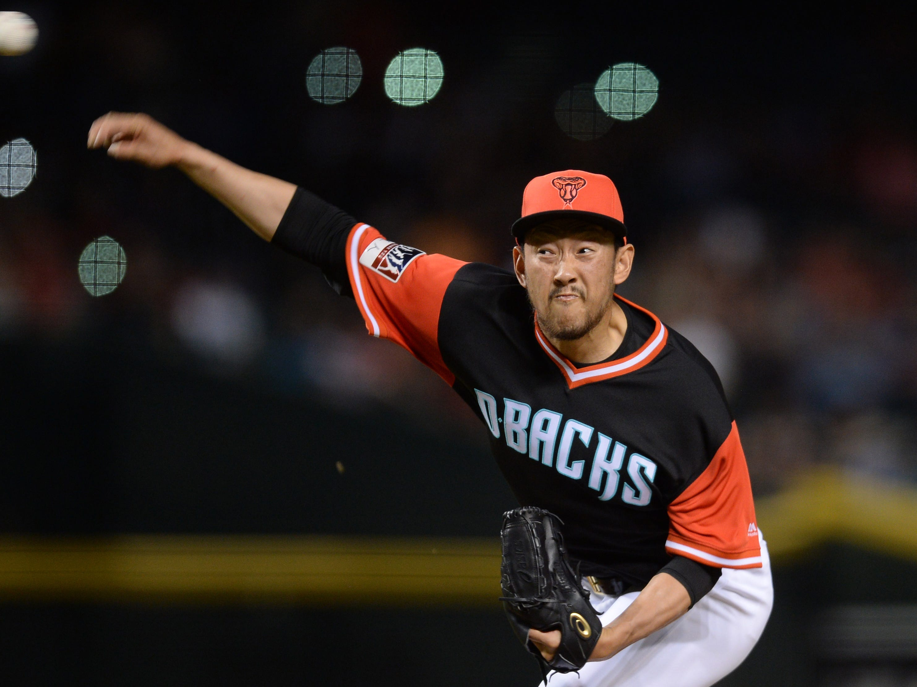Aug 25, 2018; Phoenix, AZ, USA; Arizona Diamondbacks relief pitcher Yoshihisa Hirano (66) pitches against the Seattle Mariners during the eighth inning at Chase Field. Mandatory Credit: Joe Camporeale-USA TODAY Sports