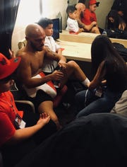 Ray Beltran and his three children comfort one another in the dressing room after his 12-round decision loss to Jose Pedraza on Saturday night at Gila River Arena in Glendale.