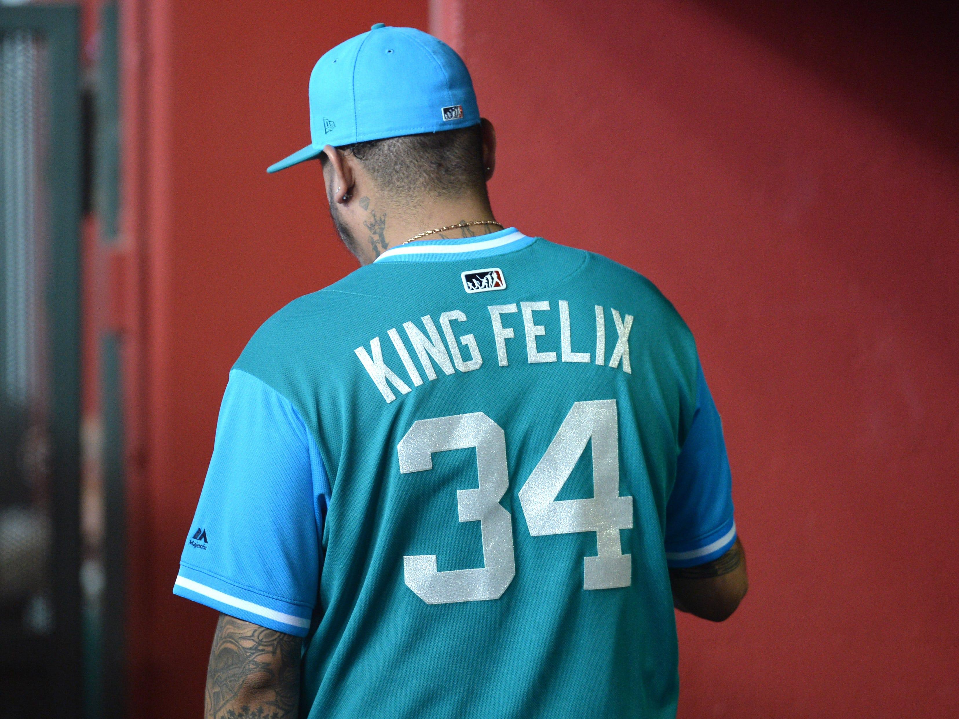 Aug 25, 2018; Phoenix, AZ, USA; Seattle Mariners starting pitcher Felix Hernandez (34) walks the dugout during the first inning against the Arizona Diamondbacks at Chase Field. Mandatory Credit: Joe Camporeale-USA TODAY Sports
