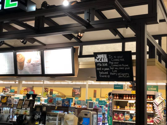 A sign in the Cottonwood Safeway remembers Sen. John McCain one day after his death.