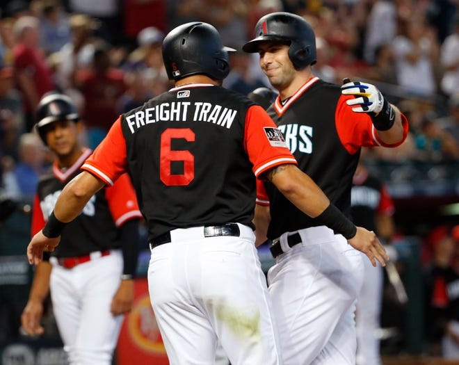 Arizona Diamondbacks first baseman Paul Goldschmidt (right) celebrates his three-run home run against the Seattle Mariners with right fielder David Peralta (6) during the third inning at Chase Field in Phoenix, Ariz. August 26. 2018.
