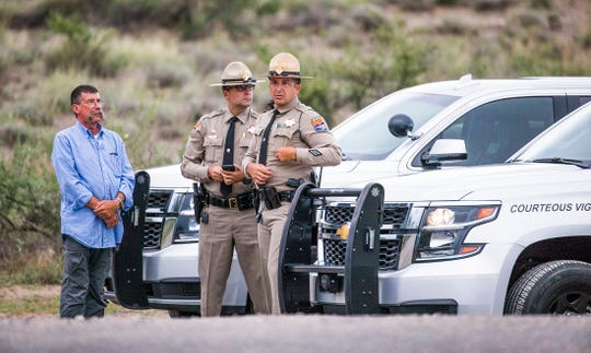 Arizona Department of Public Safety troopers seen in August at a road block near Cornville after the death of Sen. John McCain.