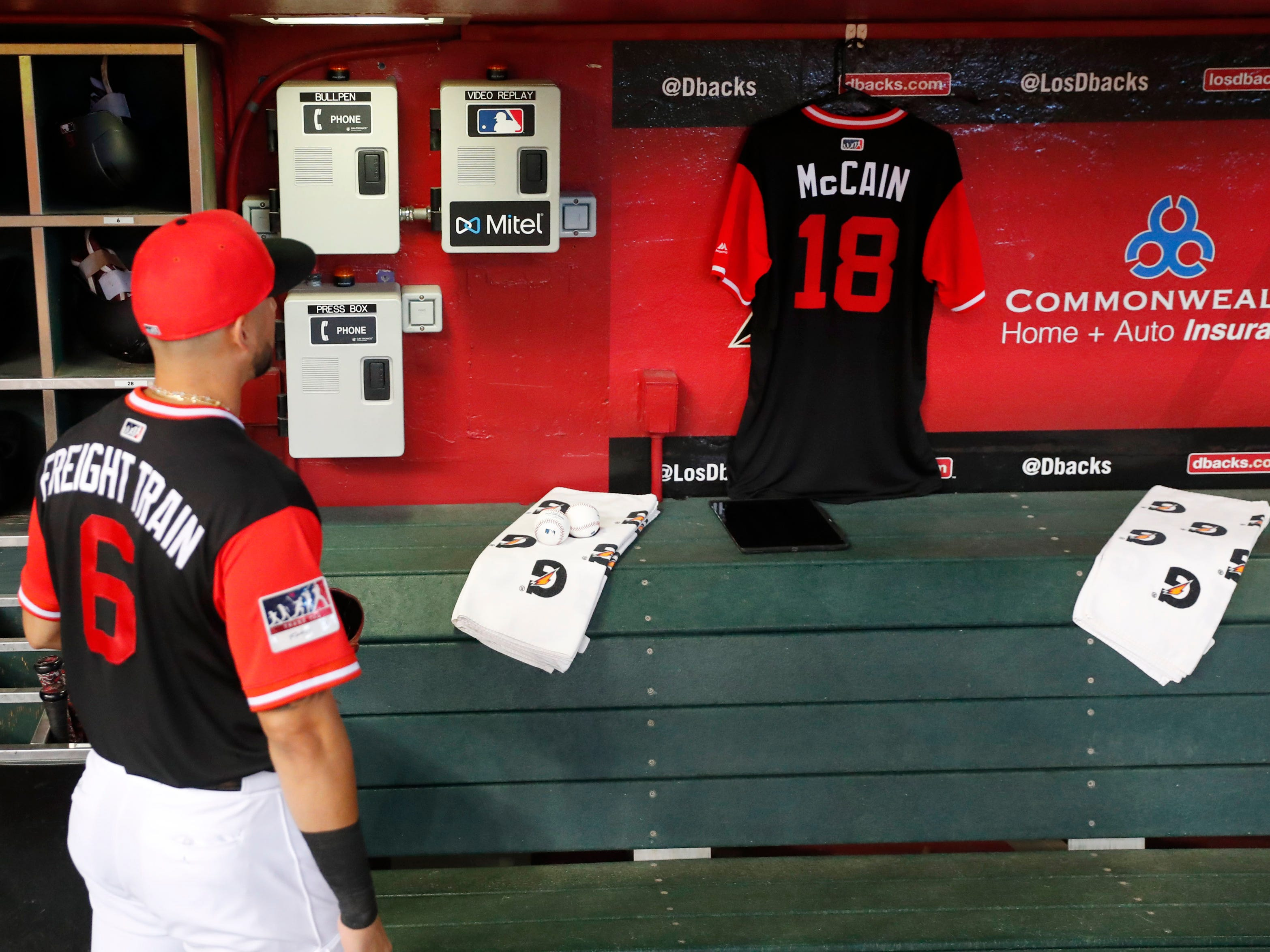 Arizona Diamondbacks right fielder David Peralta looks at a jersey hanging in the dugout for Sen. John McCain before playing against the Seattle Mariners at Chase Field in Phoenix, Ariz. August 26. 2018. The six-term Arizona senator died Saturday at age 81.