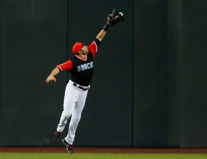 Arizona Diamondbacks center fielder A.J. Pollock (11) plays the ball off the wall hit by Seattle Mariners right fielder Mitch Haniger during the fifth inning at Chase Field in Phoenix, Ariz. August 26. 2018.