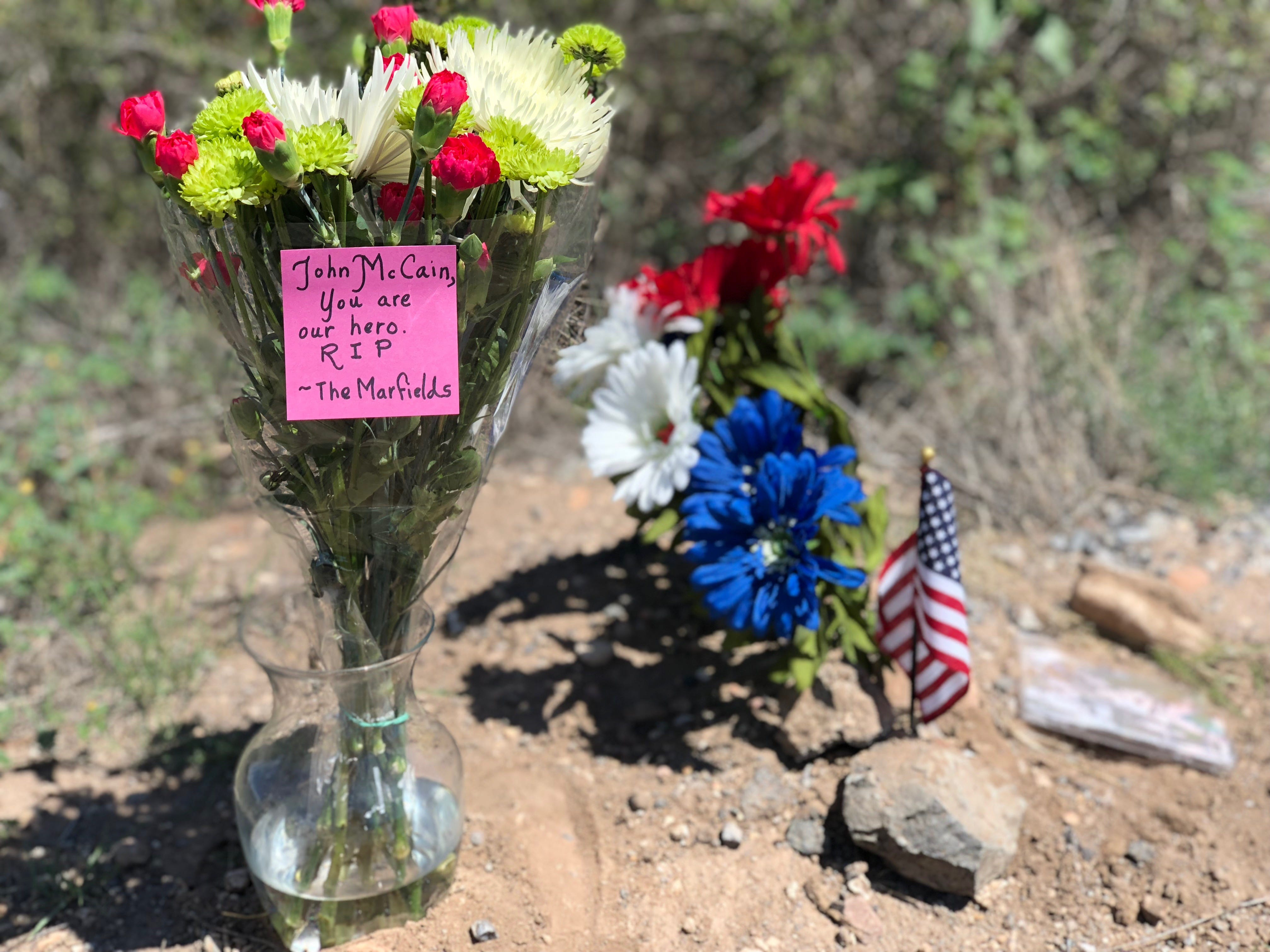 Visitors to a memorial near the McCain family's ranch left flowers, small American flags and letters for the senator's family.
