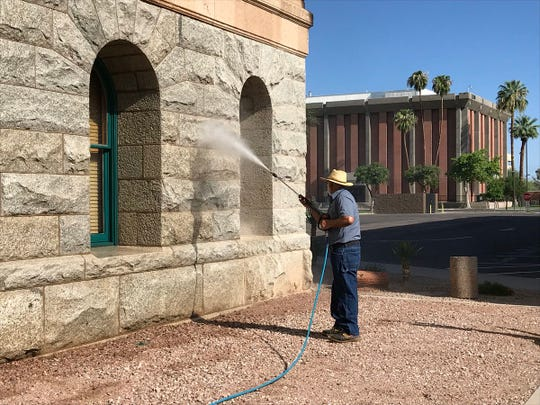 Crews power wash the Arizona Capitol building, where John McCain will lie in state on Wednesday.