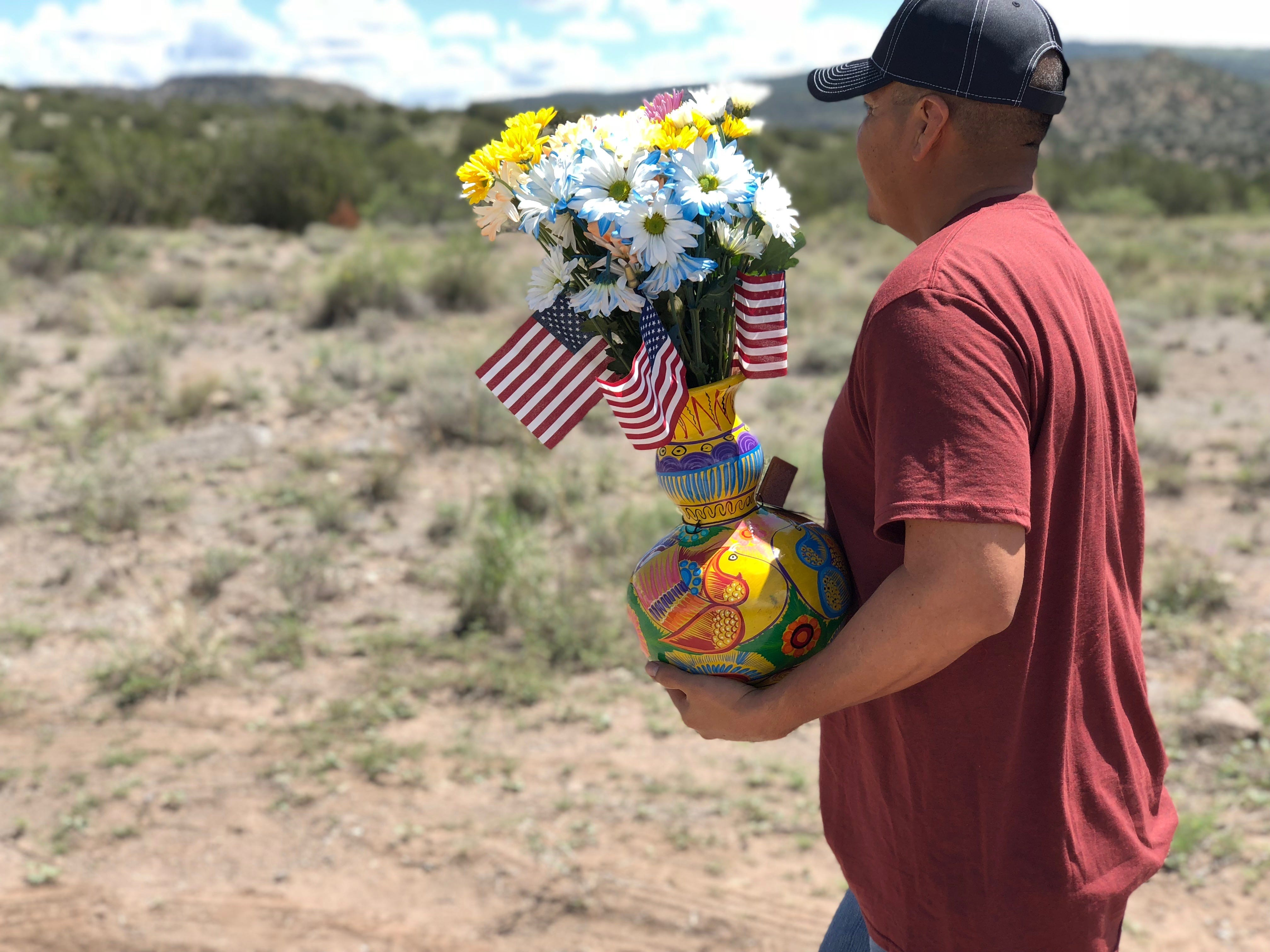 Luis Aniceto, 43, drove from Phoenix to a memorial near Sen. John McCain's ranch Sunday morning to pay respect and leave flowers.