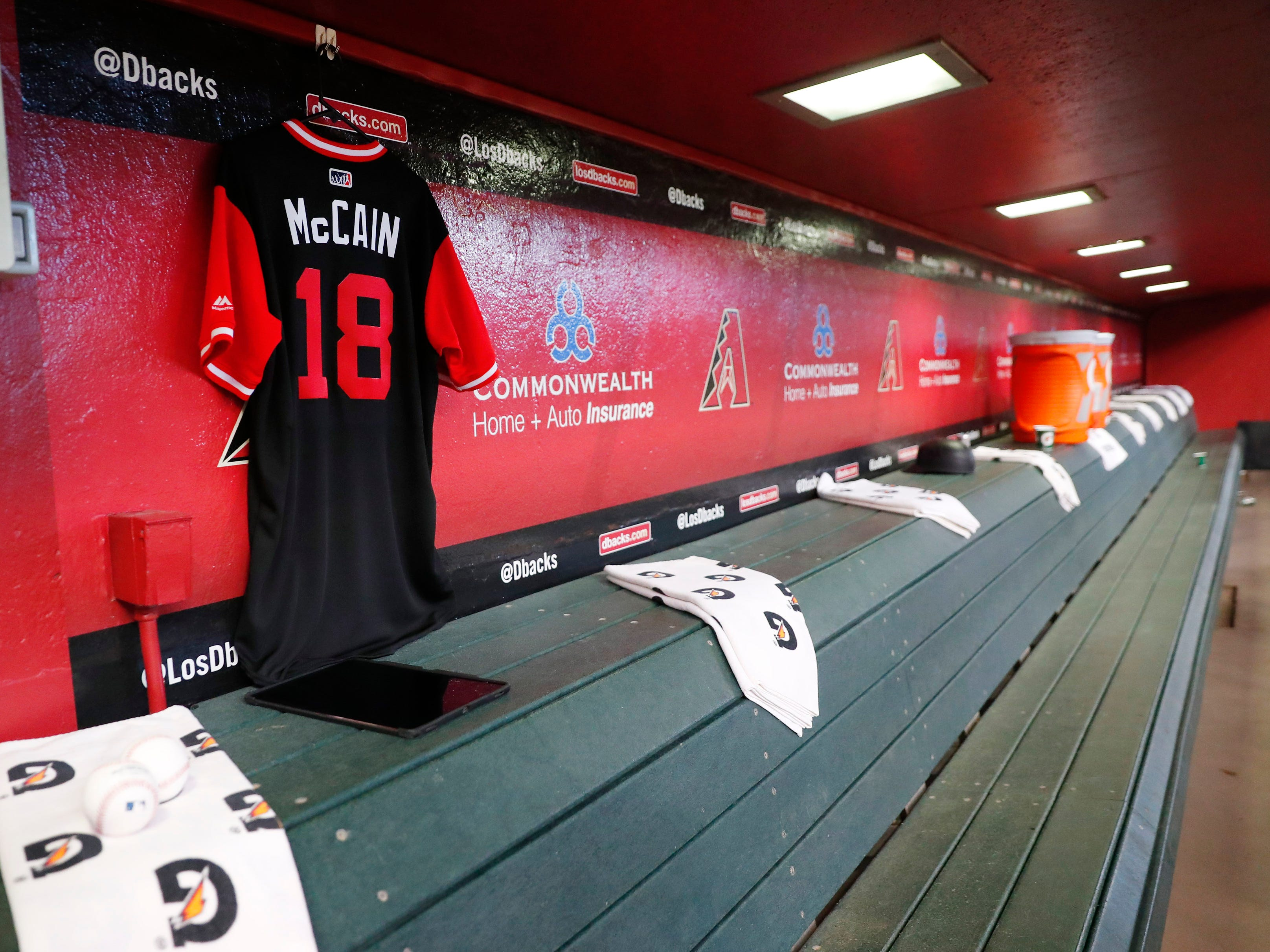 A jersey for Sen. John McCain hangs in the dugout before the Arizona Diamondbacks play against the Seattle Mariners at Chase Field in Phoenix, Ariz. August 26. 2018. The six-term Arizona senator died Saturday at age 81.