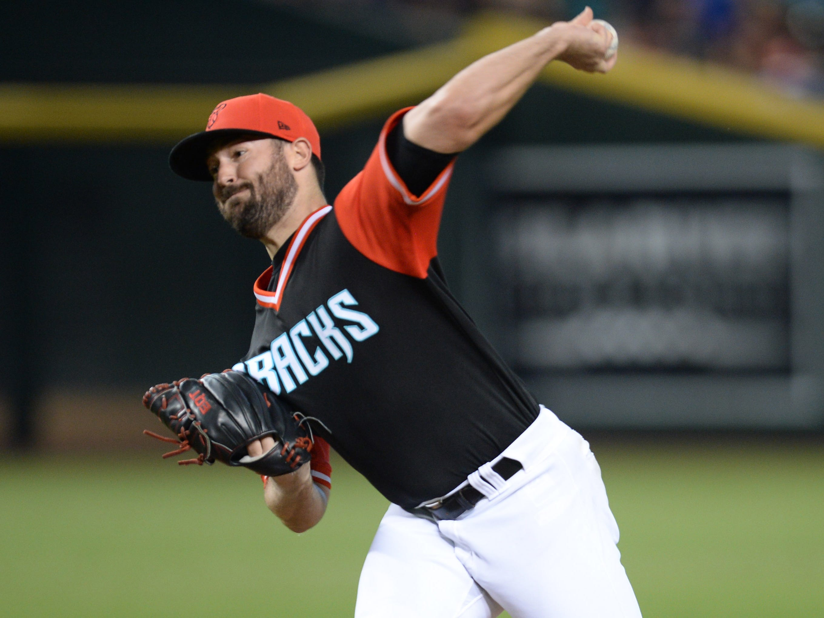 Aug 25, 2018; Phoenix, AZ, USA; Arizona Diamondbacks starting pitcher Robbie Ray (38) pitches against the Seattle Mariners during the first inning at Chase Field. Mandatory Credit: Joe Camporeale-USA TODAY Sports