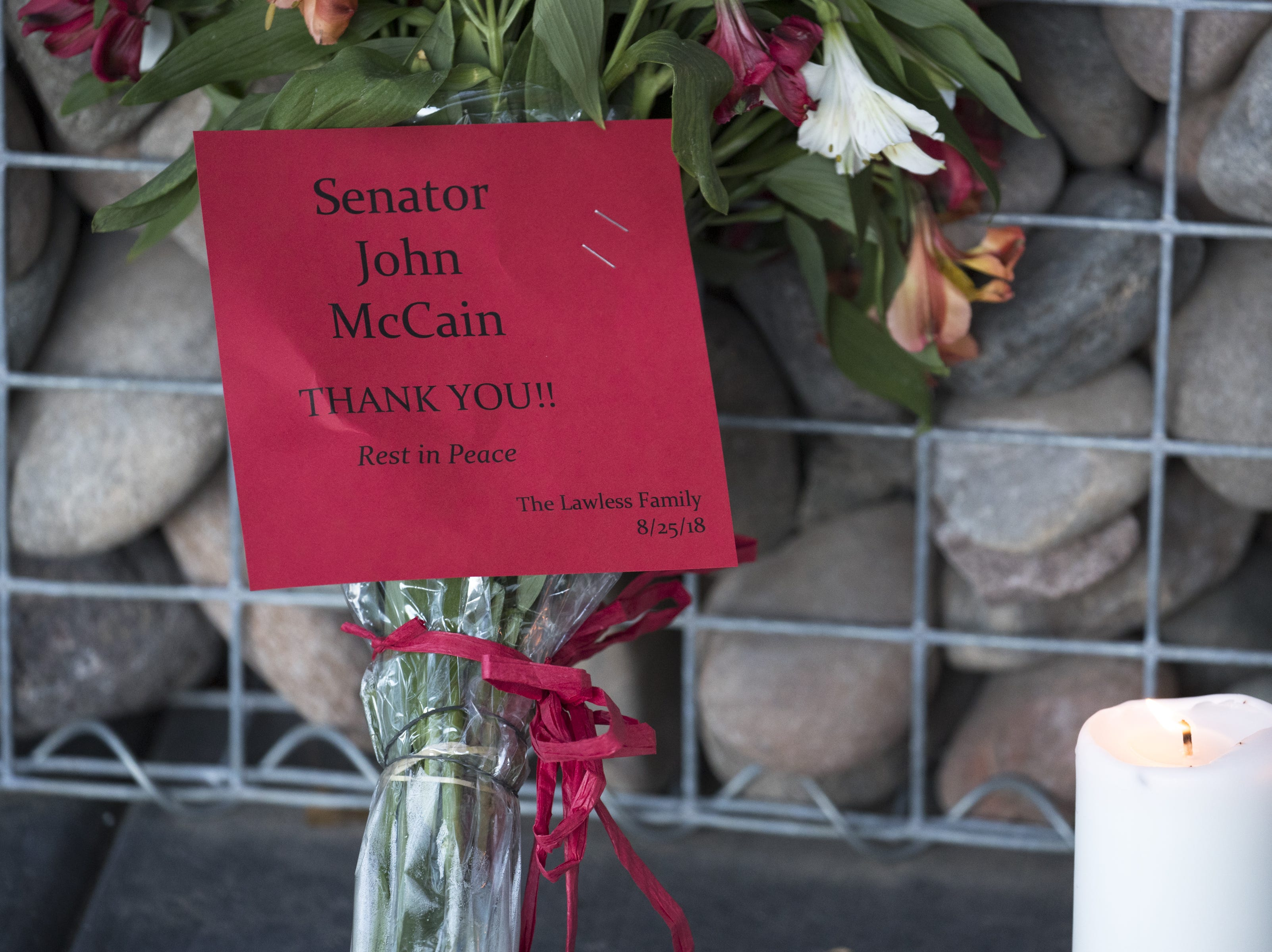 A makeshift memorial to honor Sen. John McCain formed outside his office on Aug. 26, 2018, in Phoenix.