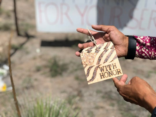 Vincent Hood holds a wood etching he made for Sen. John McCain on Sunday, Aug. 26.