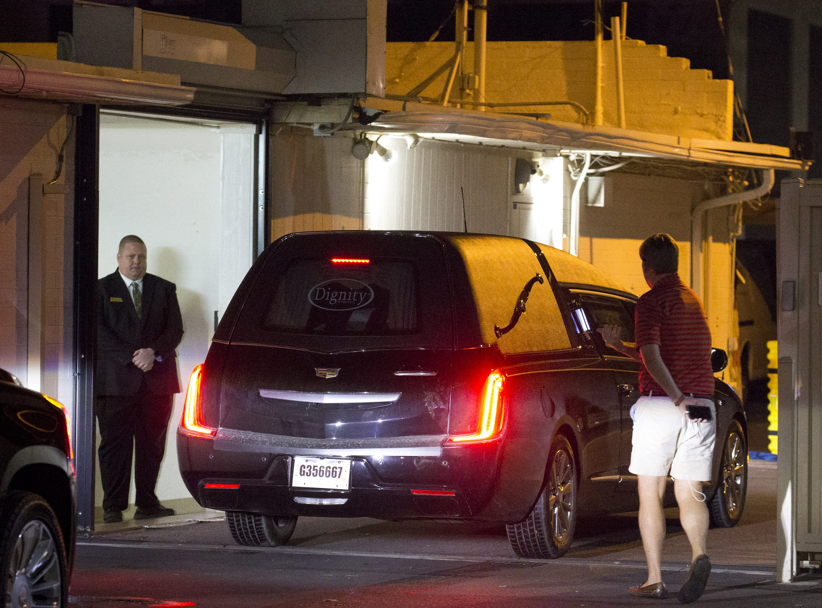 The hearse carrying the body of Sen. John McCain arrives at the A. L. Moore Grimshaw Mortuary on Aug. 25, 2018.