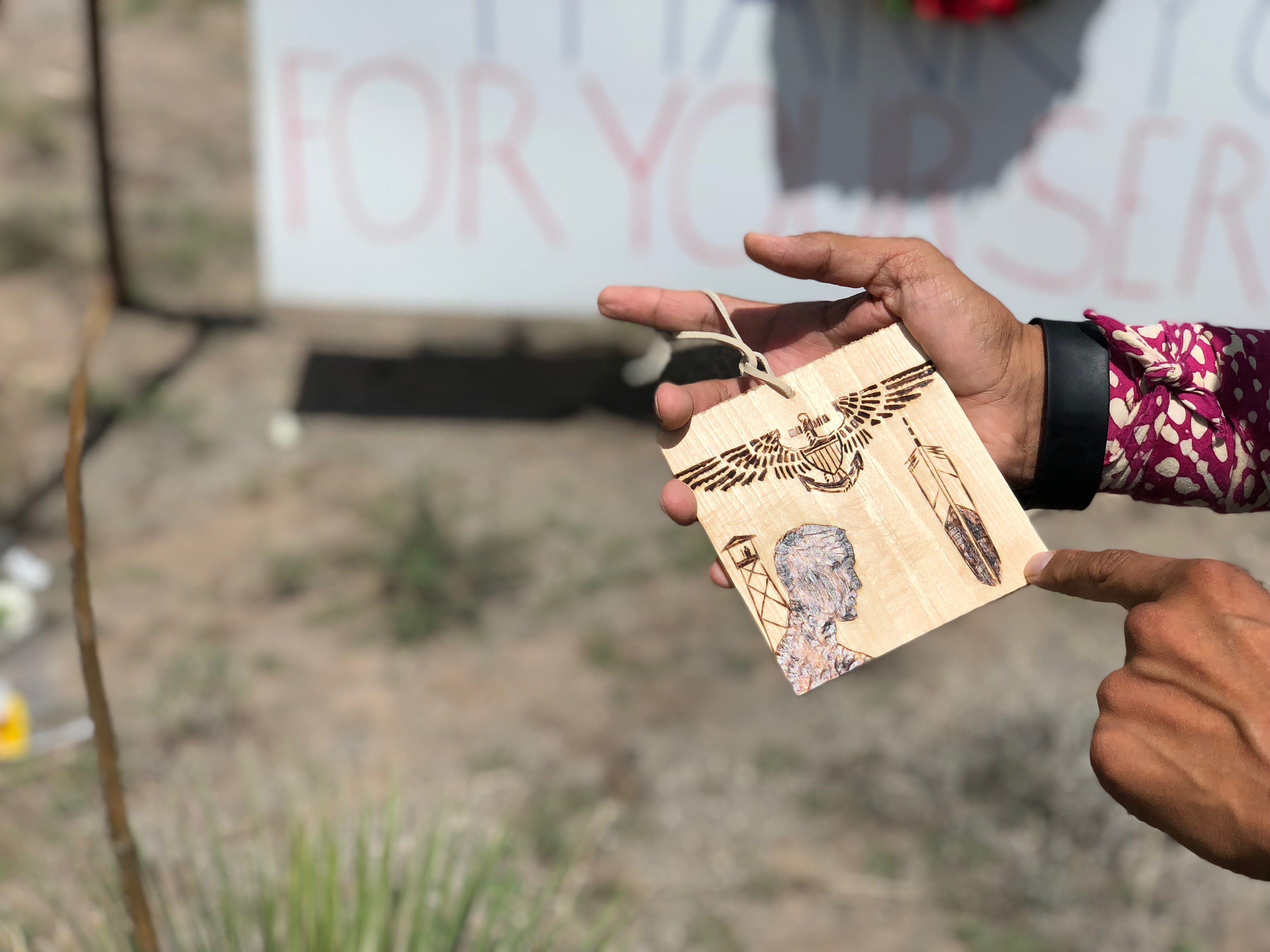 Yavapai-Prescott Indian Tribe resident Vincent Hood holds a wood etching he made for Sen. John McCain.
