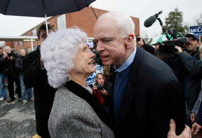 Republican presidential hopeful Sen. John McCain, R-Ariz., gets a hug from his 95-year-old mother Roberta as he arrives at a polling station on the day of South Carolina's Republican presidential primary in Charleston, S.C., Jan. 19, 2008. (AP Photo/Charles Dharapak)
