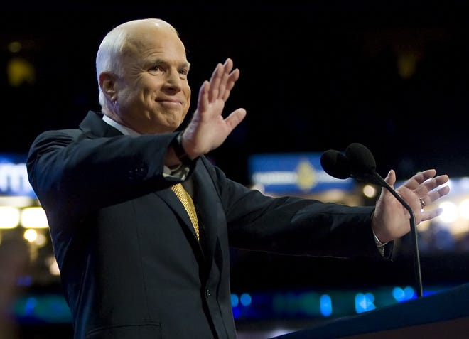 REPUBLICAN CONVENTION 9/4/08  Sen. John McCain waves to the crowd after speaking to his party during the Republican National Convention at the Xcel Energy Center in St. Paul, MN  September 4, 2008.  photo by MICHAEL CHOW/THE ARIZONA REPUBLIC