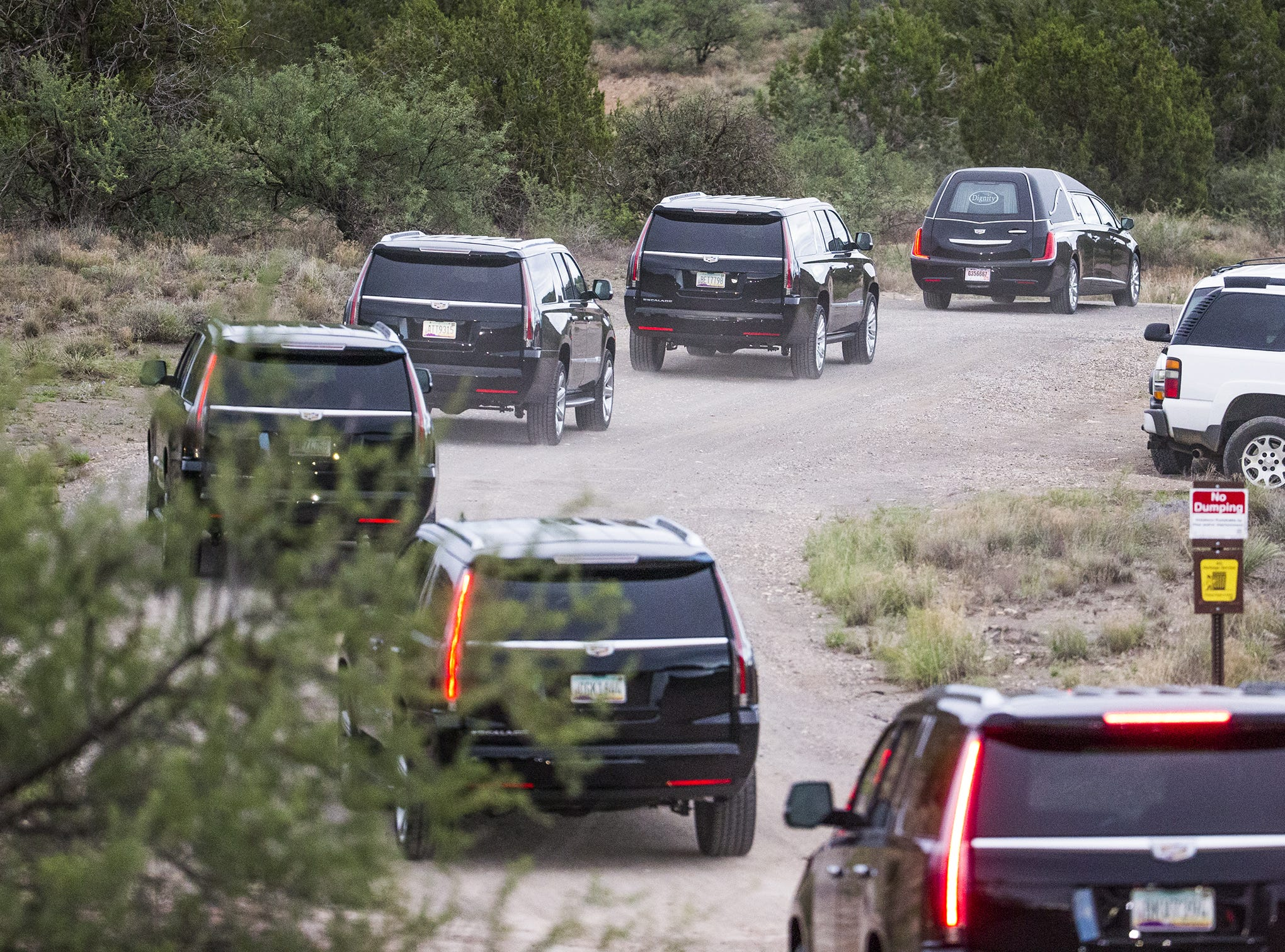 A hearse leads the way up the road to Sen. John McCain's home in Cornville on Aug. 25, 2018.  The road leads to the compound where Sen. John McCain died Saturday.