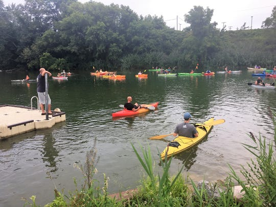Kayakers prepare to leave from Bakers Field Park in Port Huron Township for the 2018 Port Huron Paddle Fest on Aug. 26, 2018.
