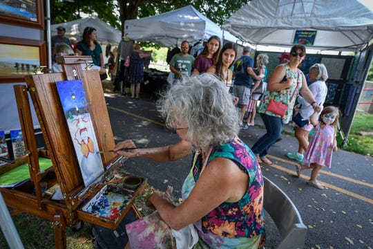 Visitors of the final day of the Yorkfest Fine Arts Festival watch Mary Ann Vessey of Staunton VA. paint along the York County Heritage Rail Trail, Sunday, August 26, 2018. John A. Pavoncello photo