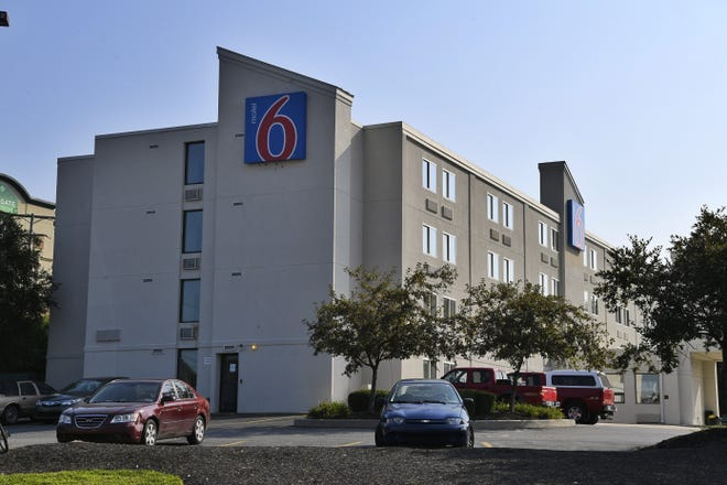 Officials say a man was shot and killed after opening fire on police officers attempting to take him into custody at the Motel 6 in Machest we r Township, Saturday. John A. Pavoncello photo