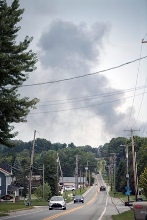 A pillar of smoke rises over East Prospect Road in Windsor Township
