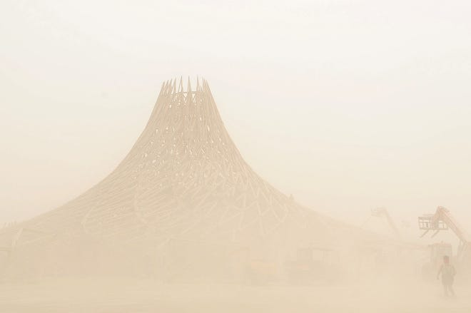 The Galaxia temple is seen through blowing dust Sunday at Black Rock City during Burning Man. The gates into the event were closed Sunday afternoon until the weather clears.