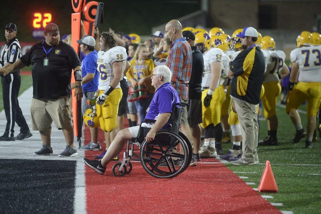 Retired principal Mark Childs (in wheelchair) on the sidelines with Hagerstown's football team during a football game between Hagerstown and Centerville Saturday, Aug. 25, 2018 at Ball State University's Scheumann Stadium. Hagerstown won 32-26.