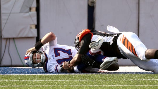 Bills rookie quarterback Josh Allen is pressured by Bengals Carlos Dunlap and hits his head on the turf.  He was removed from the game a play later and checked for a concussion.