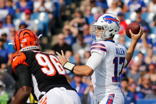 Buffalo Bills quarterback Josh Allen (17) throws a pass during the first half of a preseason NFL football game as Cincinnati Bengals' Carlos Dunlap (96) rushes him Sunday, Aug. 26, 2018, in Orchard Park, N.Y. (AP Photo/Jeffrey T. Barnes)