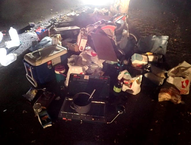 Redding police collected trash and personal property from South City Park in a quality-of-life sweep on Wednesday, Aug. 22, 2018.