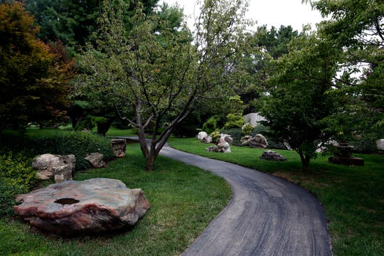 Twilight garden features can range from massive boulders and paths to trees and understory plants. The important thing is to consider how you will use your space before planting it.