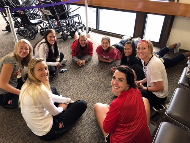 St. Cloud State University volleyball players wait Saturday in the airport for their flight home from Hawaii.
